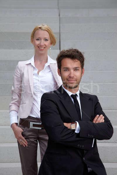 Iş ekibi adam kadın iş adamı merdiven gülümseme Stok fotoğraf © armstark