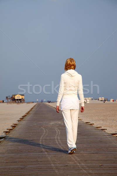 женщину пляж закат небе солнце спорт Сток-фото © armstark