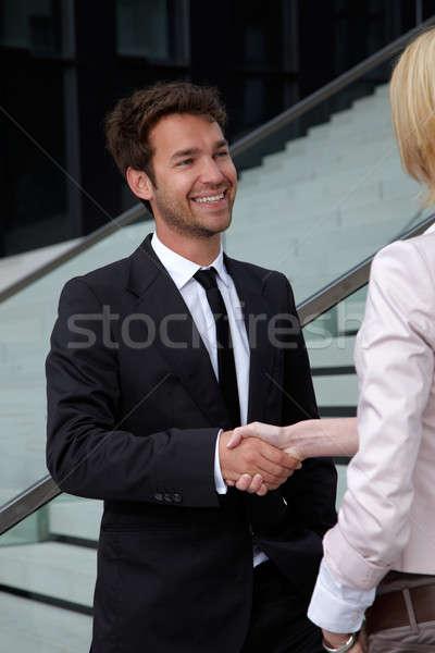 деловой человек руками женщину женщина улыбается стороны улыбка Сток-фото © armstark