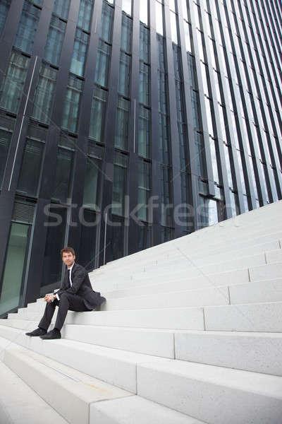 Iş adamı merdiven oturma adımlar ev işadamı Stok fotoğraf © armstark