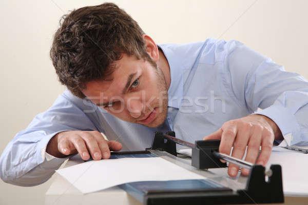 Adam kesmek kâğıt mavi makine gömlek Stok fotoğraf © armstark
