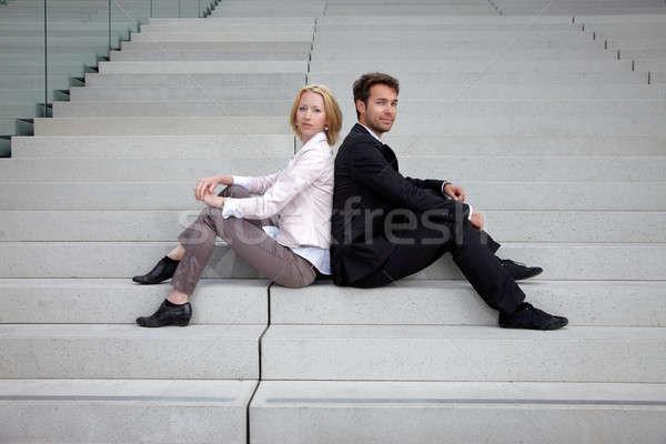 Kadın adam oturma merdiven iş çalışmak Stok fotoğraf © armstark