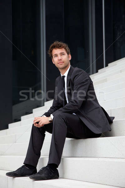 business man siting on stairs Stock photo © armstark