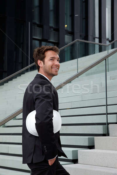Iş adamı ayakta merdiven kask adam mutlu Stok fotoğraf © armstark