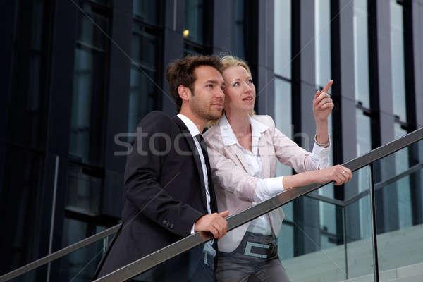 Kadın adam bakıyor iş Bina Stok fotoğraf © armstark
