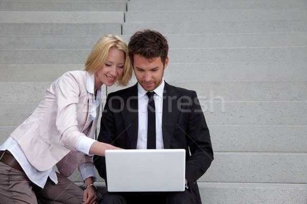 Iş adamı dizüstü bilgisayar kadın iş bilgisayar gülümseme Stok fotoğraf © armstark