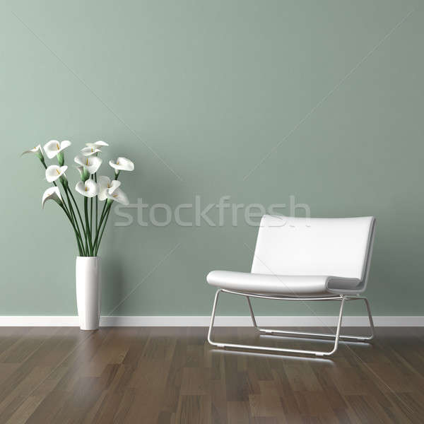 Stock photo: white barcelona chair on green