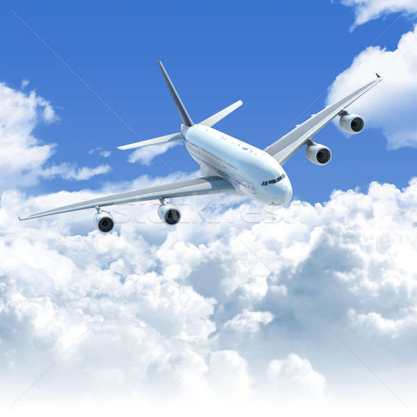 Stock photo: airplane flying over the clouds front top view