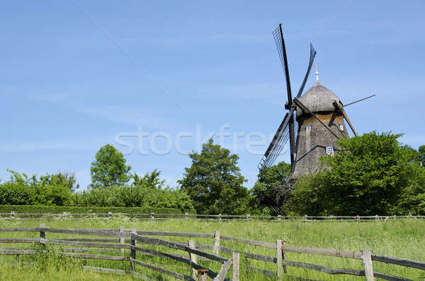 Traditional wooden wind mill Stock photo © Arrxxx