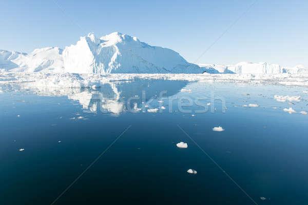 Stock fotó: Gyönyörű · jéghegy · körül · kék · ég · víz · tenger