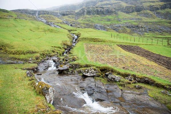 Landschap rond eilanden waterval groen gras water Stockfoto © Arrxxx