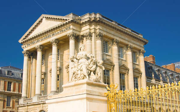 Statue and palace facade with columns in Versailles Stock photo © Arsgera