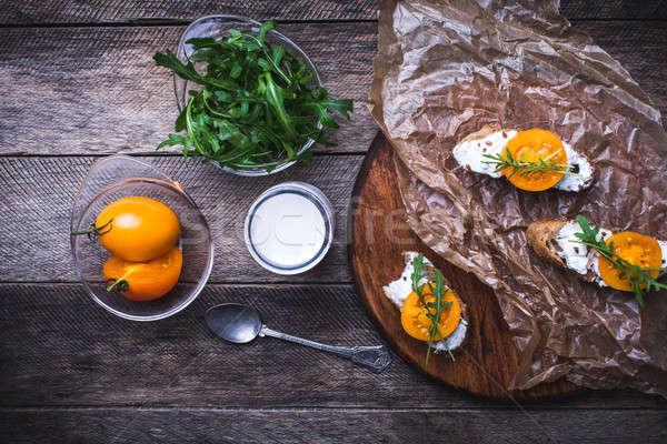 Bruschetta paradicsomok tábla rusztikus stílus étel Stock fotó © Arsgera