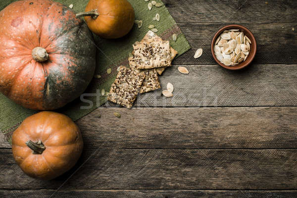 Stock photo: pumpkins with cookies and seeds in Rustic style