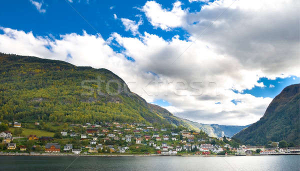 Montanhas aldeia norueguês fiorde blue sky nuvens Foto stock © Arsgera