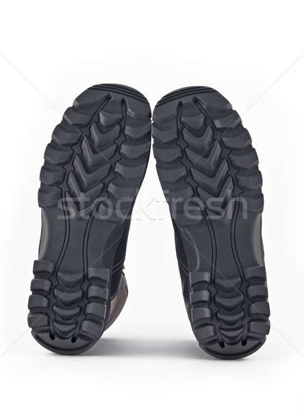 Stock photo: Rubber sole of boots over white