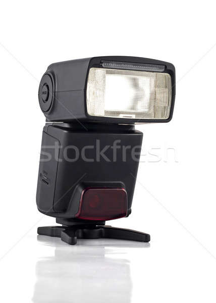 Professional flash on stand for digital camera isolated Stock photo © Arsgera