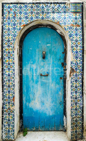 Blue aged door with ornament and tiles from Sidi Bou Said in Tun Stock photo © Arsgera