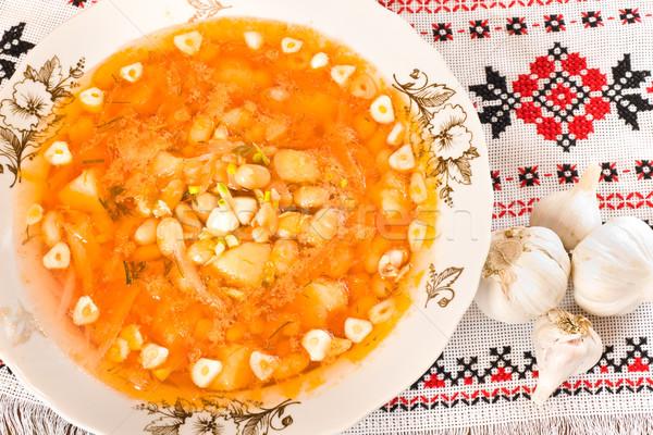 In the restaurant - borsch and garlic heads Stock photo © Arsgera