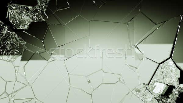 Demolished and cracked glass on black Stock photo © Arsgera