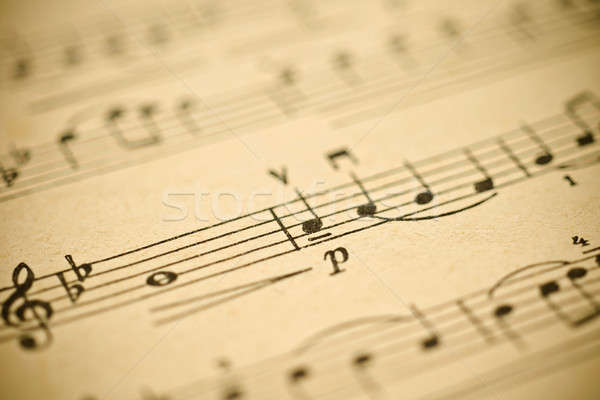 Classical music - notes on yellowed vintage paper sheet  Stock photo © Arsgera