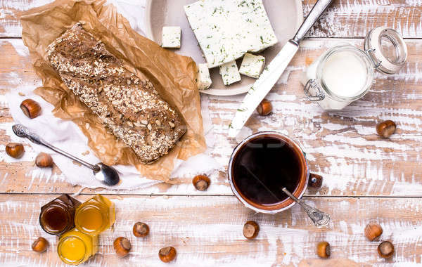 Morning tea Bread with seeds and cheese on wooden table Stock photo © Arsgera