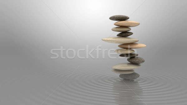 Armonia equilibrio ciottoli acqua cielo blu Foto d'archivio © Arsgera
