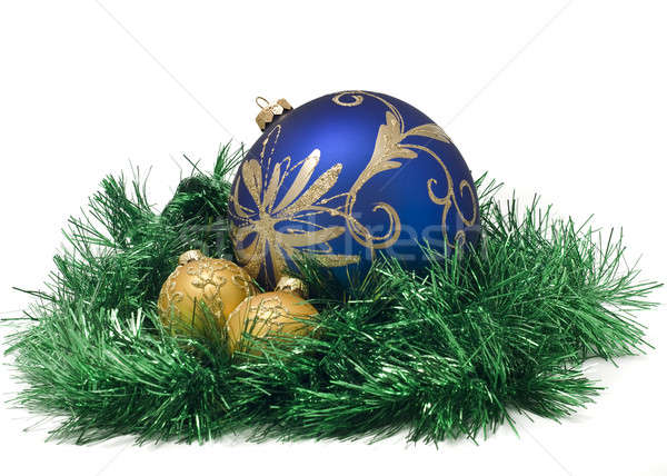 Three Beautiful Christmas or New Year balls in green tinsel  Stock photo © Arsgera