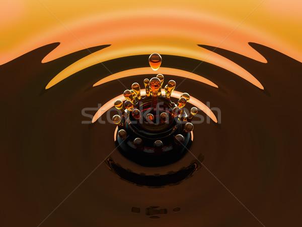 Arancione colorato fluido splash bellezza drop Foto d'archivio © Arsgera