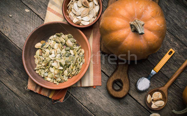 Rustic style pumpkins with seeds on wood Stock photo © Arsgera