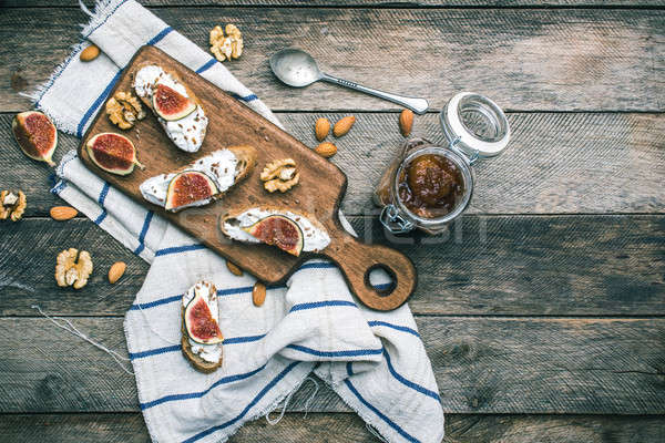 snacks with cheese jam and figs on wood Stock photo © Arsgera