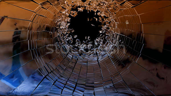 Bullet hole: pieces of shattered glass Stock photo © Arsgera