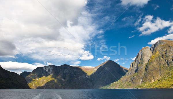 Montanhas norueguês fiorde nuvens blue sky céu Foto stock © Arsgera