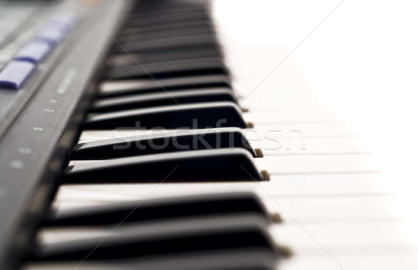 Extreme Closeup of piano keyboard Stock photo © Arsgera