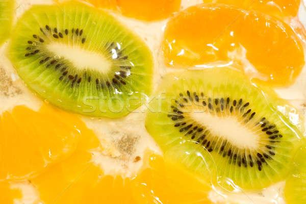 Fruit background. Kiwi and mandarin Stock photo © Arsgera
