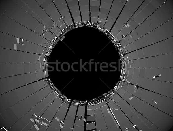 Shattered glass over black background Stock photo © Arsgera