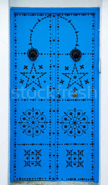 Blue door with ornament from Sidi Bou Said in Tunisia Stock photo © Arsgera