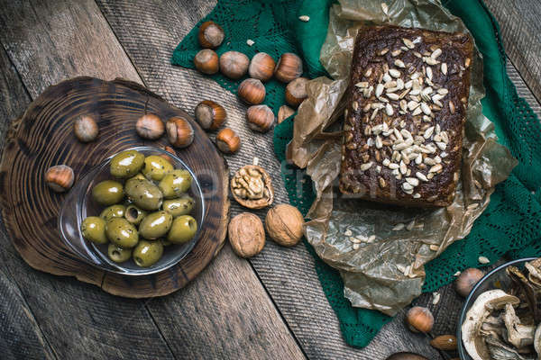 Green olives, nuts mushrooms  and bread with seeds Stock photo © Arsgera