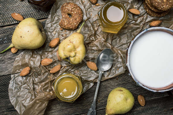 pastry pears honey and yoghurt on wooden table Stock photo © Arsgera