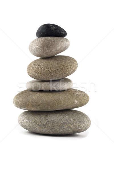 Kiegyensúlyozott kő boglya torony izolált fehér Stock fotó © Arsgera