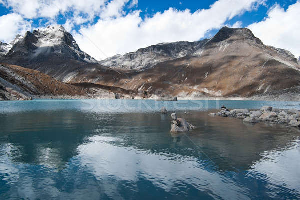 Balance and harmony: Stone stacks and Sacred Lake near Gokyo Stock photo © Arsgera