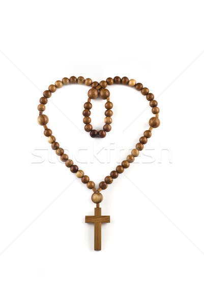 Heart figure made of Wooden beads isolated Stock photo © Arsgera