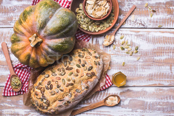 Newly baked white bread with seeds and pumpkin on wood Stock photo © Arsgera