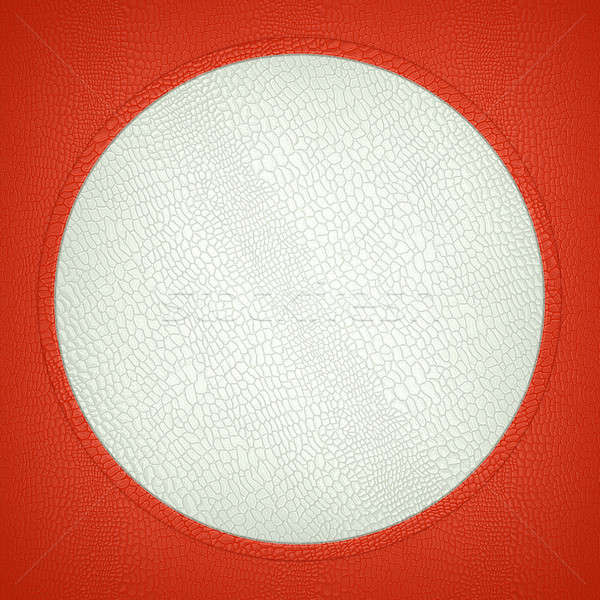 Red and white stitched circle shape on mock croc Stock photo © Arsgera
