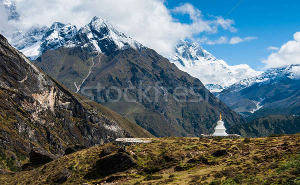 Buddhist stupe or chorten and Lhotse peaks in Himalayas Stock photo © Arsgera