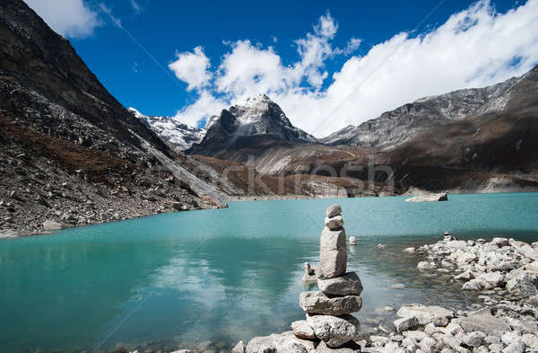 Harmony and balance: Pebble stack and Sacred Lake in Himalayas Stock photo © Arsgera