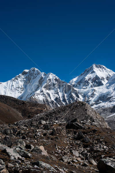 Snowbound mountain peaks and blue sky in Himalayas Stock photo © Arsgera