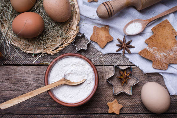 Flour and eggs for Christmas pastry and holiday cookies  Stock photo © Arsgera
