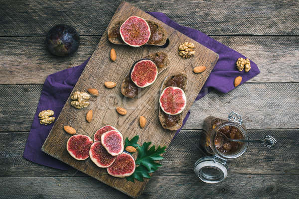 figs, nuts and bread with jam on choppingboard in rustic style Stock photo © Arsgera