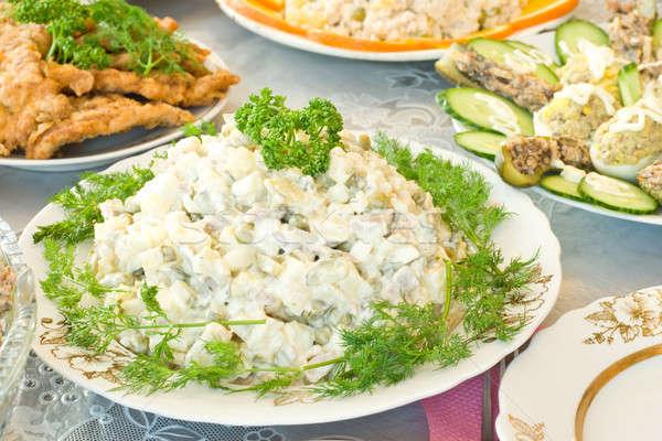 Banquet in the restaurant, Russian salad Stock photo © Arsgera